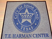 Custom Made Logo Mat Purchased On GSA Contract - Custom Made Logo Mat Purchased On GSA Contract - City Of Sugarland Texas Municipal Building