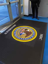 Custom Made Logo Mat Purchased On GSA Contract - Department Of Justice Metropolitan Detention Center Brooklyn New York